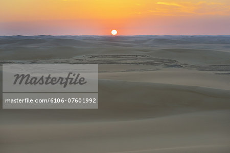 Desert Landscape at Sunrise Stock Photo - Premium Royalty-Free, Image code: 6106-07601992