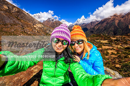 Young women taking selfie in Himalayas Stock Photo - Premium Royalty-Free, Image code: 6106-08080618
