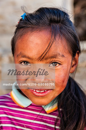 Portrait of young Sherpa girl in Everest Region Stock Photo - Premium Royalty-Free, Image code: 6106-08080795