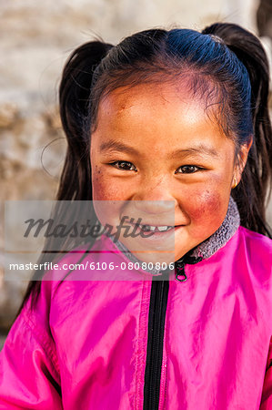 Portrait of young Sherpa girl in Everest Region Stock Photo - Premium Royalty-Free, Image code: 6106-08080806