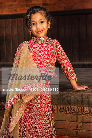 Young Nepali girl in traditional dress Stock Photo - Premium Royalty-Free, Image code: 6106-08080810