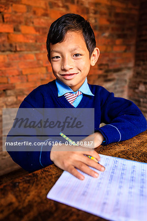 Young Nepali schoolboys in classroom Stock Photo - Premium Royalty-Free, Image code: 6106-08080817