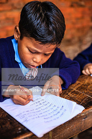 Young Nepali schoolboys in classroom Stock Photo - Premium Royalty-Free, Image code: 6106-08080818