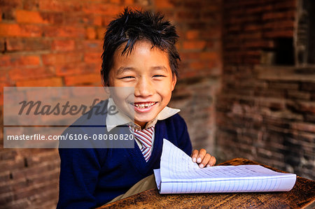 Young Nepali schoolboys in classroom Stock Photo - Premium Royalty-Free, Image code: 6106-08080820