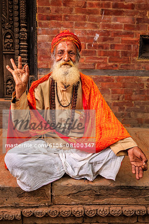 Sadhu - indian holyman sitting in the temple Stock Photo - Premium Royalty-Free, Image code: 6106-08100347