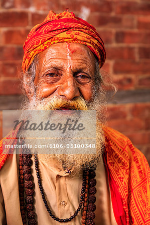 Sadhu - indian holyman sitting in the temple Stock Photo - Premium Royalty-Free, Image code: 6106-08100348