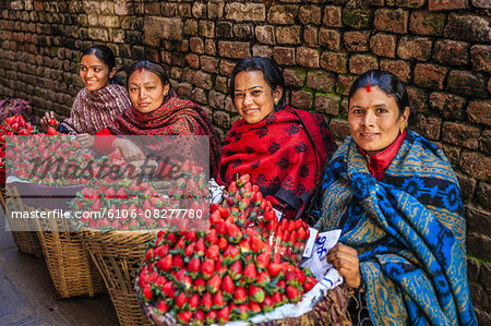 Nepali women selling strawberries on local market Stock Photo - Premium Royalty-Free, Image code: 6106-08277780