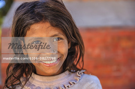 Portrait of young Nepali girl Stock Photo - Premium Royalty-Free, Image code: 6106-08277788