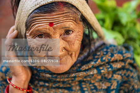 Nepali woman selling vegetables in Patan Stock Photo - Premium Royalty-Free, Image code: 6106-08277838