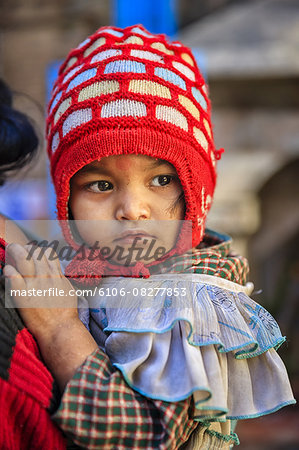 Nepali baby carrying by mother Stock Photo - Premium Royalty-Free, Image code: 6106-08277853