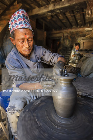 Nepali potter working in his workshop Stock Photo - Premium Royalty-Free, Image code: 6106-08277977