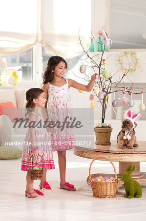 girls with easter tree Stock Photo - Premium Royalty-Free, Image code: 6106-08350712