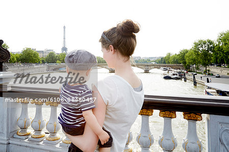 Mom and toddler boy in Paris facing Eiffel Tower Stock Photo - Premium Royalty-Free, Image code: 6106-08480457