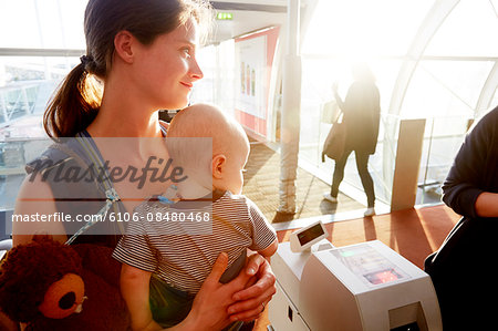 Mother and baby at gate check at airport Stock Photo - Premium Royalty-Free, Image code: 6106-08480468
