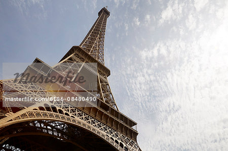 Eiffel Tower view from below and clouds Stock Photo - Premium Royalty-Free, Image code: 6106-08480490