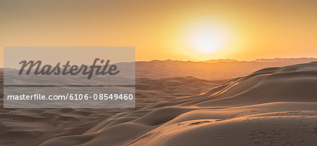 Sand dunes in the desert at sunset Stock Photo - Premium Royalty-Free, Image code: 6106-08549460
