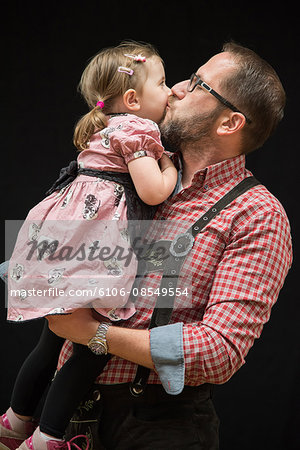 Father and Daughter Traditional Bavarian Lederhose Stock Photo - Premium Royalty-Free, Image code: 6106-08549554