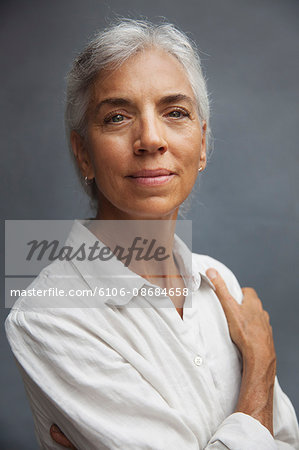 A middle aged female wearing a white shirt Stock Photo - Premium Royalty-Free, Image code: 6106-08684658