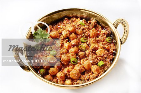 Chole masala garnished with onion rings and coriander Stock Photo - Premium Royalty-Free, Image code: 6107-06117421