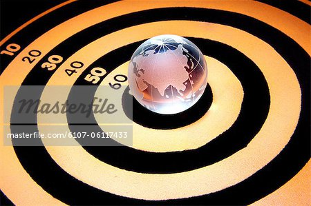 Close-up of dart board with globe on it Stock Photo - Premium Royalty-Free, Image code: 6107-06117433