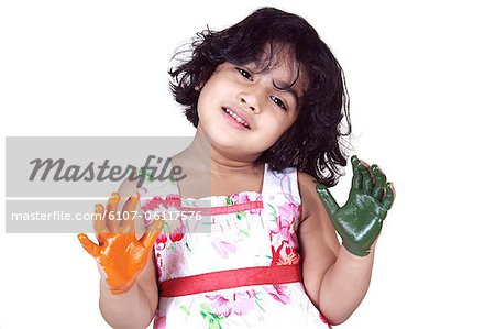 Portrait of a young girl with colored palms Stock Photo - Premium Royalty-Free, Image code: 6107-06117576
