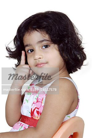 Portrait of a young girl posing Stock Photo - Premium Royalty-Free, Image code: 6107-06117578