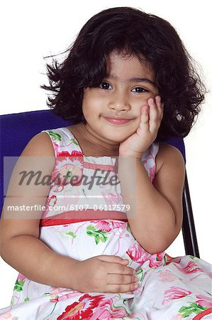 Close-up of a young girl smiling Stock Photo - Premium Royalty-Free, Image code: 6107-06117579