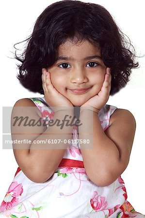 Close-up of a young girl smiling Stock Photo - Premium Royalty-Free, Image code: 6107-06117580