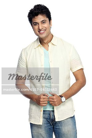 Portrait of young smiling man posing Stock Photo - Premium Royalty-Free, Image code: 6107-06117643