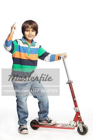 Portrait of little boy with foot push skate cycle Stock Photo - Premium Royalty-Free, Image code: 6107-06117705