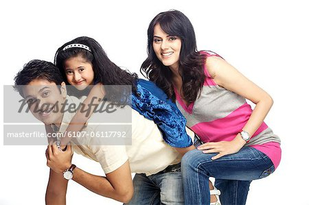 Portrait of young family Stock Photo - Premium Royalty-Free, Image code: 6107-06117792