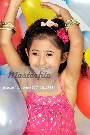 Girl Playing with balloons Stock Photo - Premium Royalty-Free, Image code: 6107-06117854