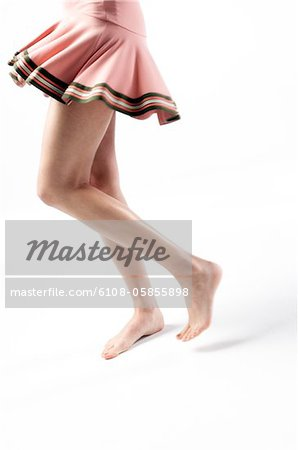 Woman legs, pink skirt, close up (studio) Stock Photo - Premium Royalty-Free, Image code: 6108-05855898