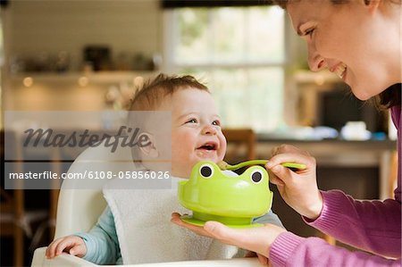 Mother feeding her baby Stock Photo - Premium Royalty-Free, Image code: 6108-05856026