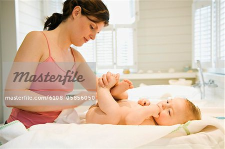 Mother and naked baby, milk cleanser Stock Photo - Premium Royalty-Free, Image code: 6108-05856050