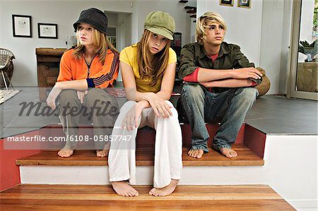 2 teenage girls and 1 teenage boy looking sullen Stock Photo - Premium Royalty-Free, Image code: 6108-05857747