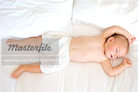 Baby sleeping, indoors Stock Photo - Premium Royalty-Free, Image code: 6108-05857909