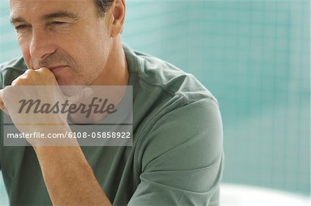 Thoughtful man's portrait Stock Photo - Premium Royalty-Free, Image code: 6108-05858922