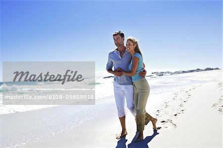 Couple walking on the beach Stock Photo - Premium Royalty-Free, Image code: 6108-05859018