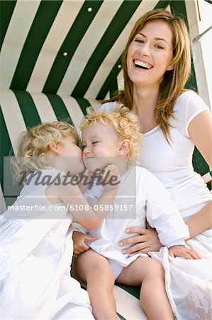 Mother and 2 children on a swing chair Stock Photo - Premium Royalty-Free, Image code: 6108-05859157