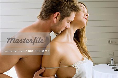 Mid adult man and a young woman romancing Stock Photo - Premium Royalty-Free, Image code: 6108-05860719