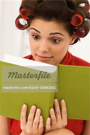 Close-up of a woman reading a book Stock Photo - Premium Royalty-Free, Image code: 6108-05861811