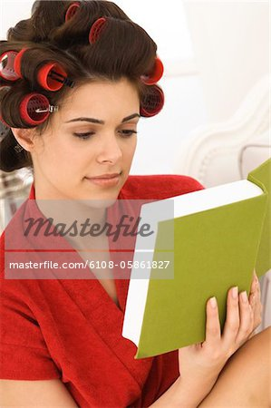 Close-up of a woman reading a book Stock Photo - Premium Royalty-Free, Image code: 6108-05861827