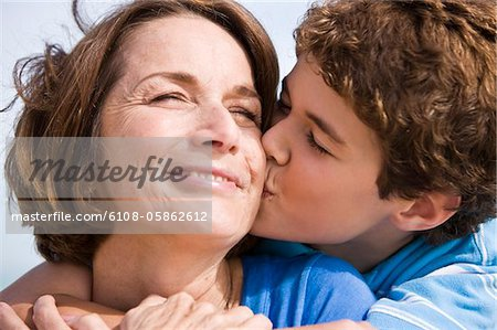 Boy kissing his grandmother Stock Photo - Premium Royalty-Free, Image code: 6108-05862612