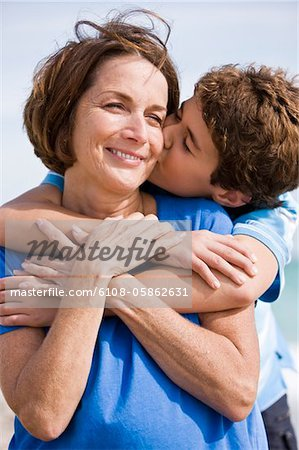 Boy kissing his grandmother Stock Photo - Premium Royalty-Free, Image code: 6108-05862631