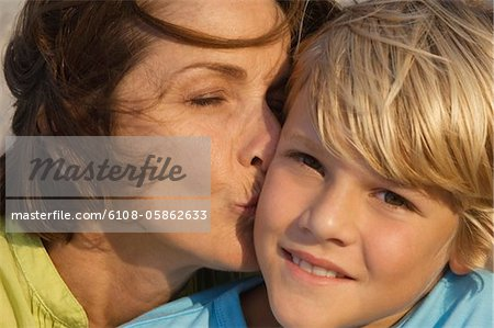 Woman kissing her grandson Stock Photo - Premium Royalty-Free, Image code: 6108-05862633