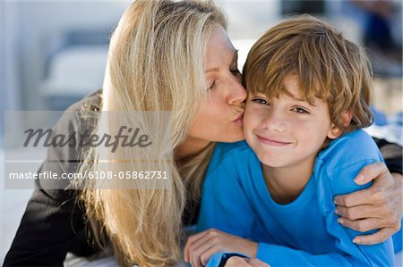 Woman kissing her son Stock Photo - Premium Royalty-Free, Image code: 6108-05862731