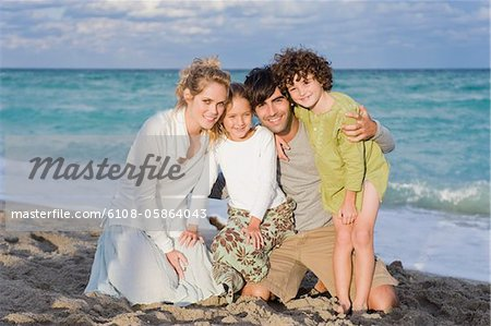 Portrait of a family smiling Stock Photo - Premium Royalty-Free, Image code: 6108-05864043