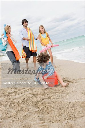 Family enjoying vacations on the beach Stock Photo - Premium Royalty-Free, Image code: 6108-05864156