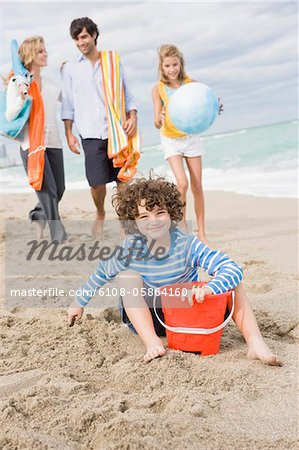Family enjoying vacations on the beach Stock Photo - Premium Royalty-Free, Image code: 6108-05864160